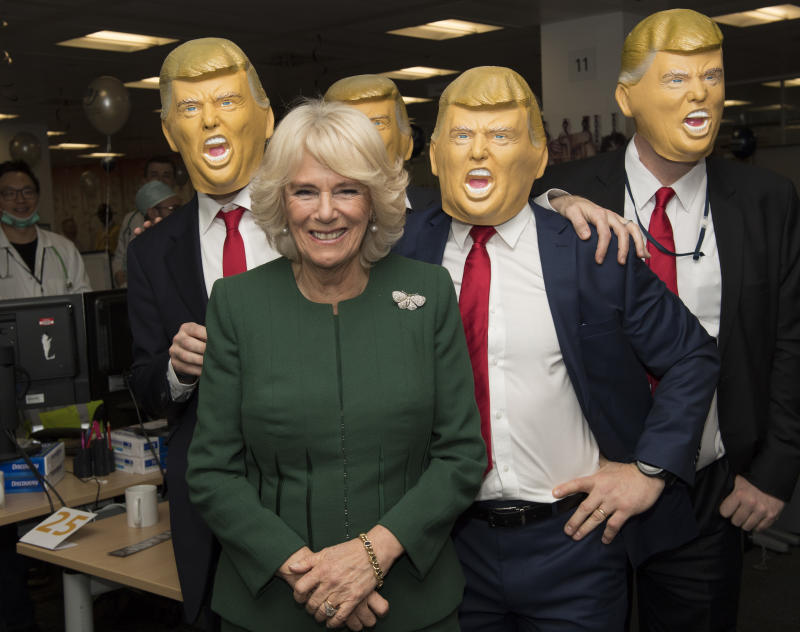 Camilla posed with several joke Trump heads at a charity event in 2017. Photo: Getty