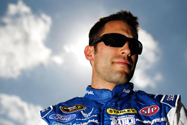 DAYTONA BEACH, FL - FEBRUARY 19: Aric Almirola, driver of the #43 Smithfield Ford, looks on after qualifying for the NASCAR Sprint Cup Series Daytona 500 at Daytona International Speedway on February 19, 2012 in Daytona Beach, Florida. (Photo by Tom Pennington/Getty Images for NASCAR)