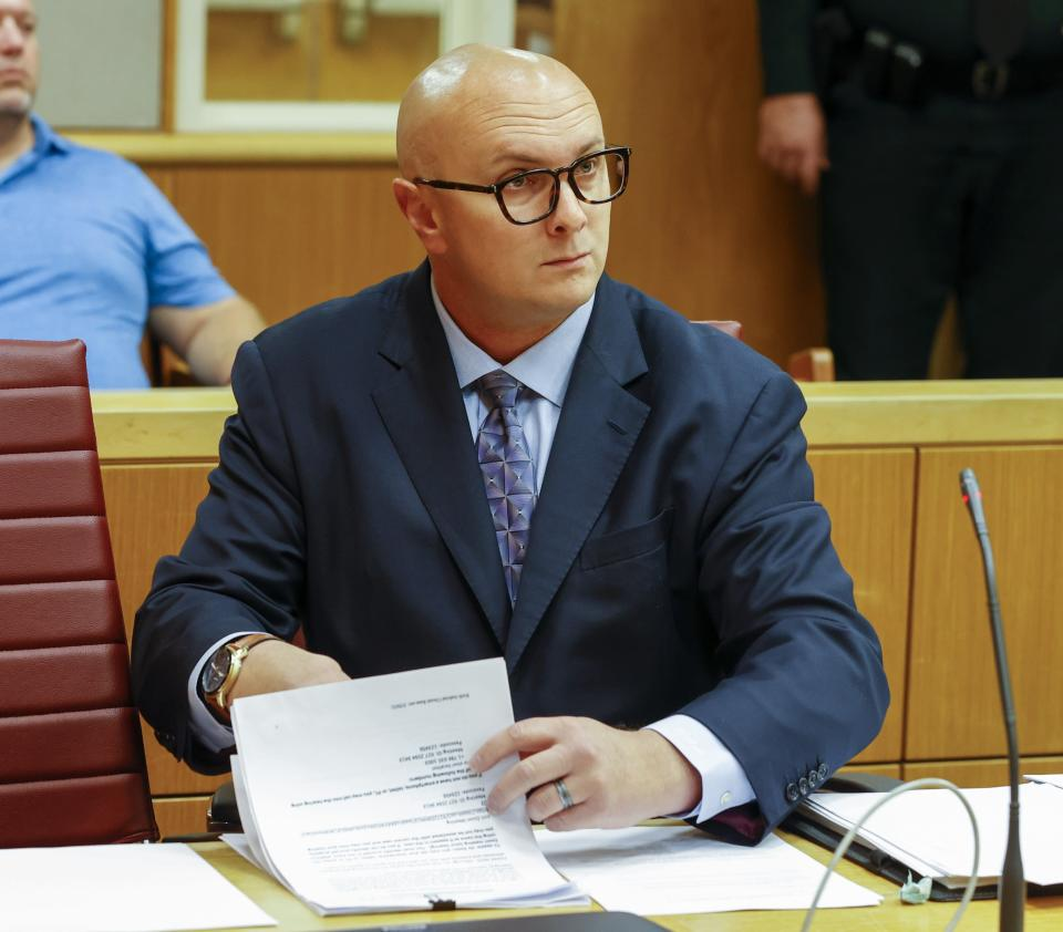 William Braddock looks through papers during a hearing, Tuesday, June 22, 2021, in Clearwater, Fla. Anna Paulina Luna, who plans to run for Florida's District 13 seat after losing a race for the slot in 2020 to Democratic U.S. Rep. Charlie Crist, contends in court documents that GOP challenger William Braddock is stalking her and wants her dead. Luna has filed a petition for a permanent restraining order. Braddock denies the claims and wants to see any evidence against him. (Chris Urso/Tampa Bay Times via AP)