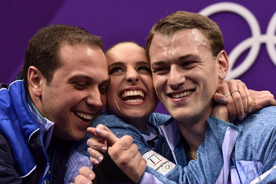 <p>Israel's Paige Conners (C) and Israel's Evgeni Krasnopolski react after competing in the pair skating short program of the figure skating event during the Pyeongchang 2018 Winter Olympic Games at the Gangneung Ice Arena in Gangneung on February 14, 2018. / AFP PHOTO / ARIS MESSINIS </p>