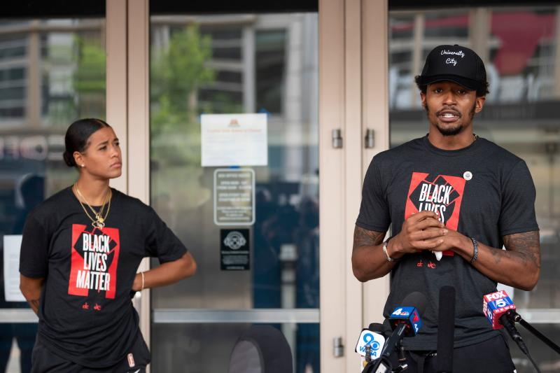 Washington Wizard NBA player Bradley Beal (right) and Washington Mystics WNBA player Natasha Cloud speak prior to a Juneteenth rally in Washington, D.C. (Jim Watson/AFP via Getty Images)