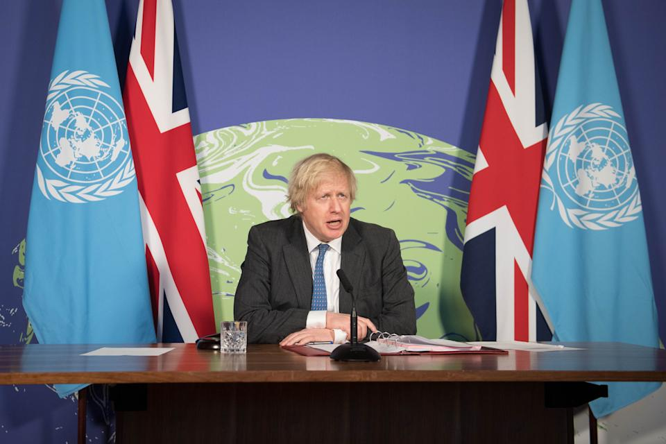LONDON, ENGLAND - FEBRUARY 23: Prime Minister Boris Johnson chairs a session of the UN Security Council on climate and security at the Foreign, Commonwealth and Development Office on February 23, 2021 in London, England. The United Kingdom holds the security council's rotating presidency and is the host nation of this year's COP26 UN climate summit in Glasgow. (Photo by Stefan Rousseau-WPA Pool/Getty Images)