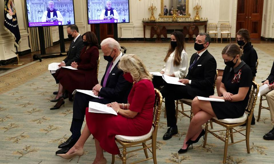 Joe Biden, Kamala Harris and their families take part virtually in an interfaith service held at the National Cathedral in Washington.