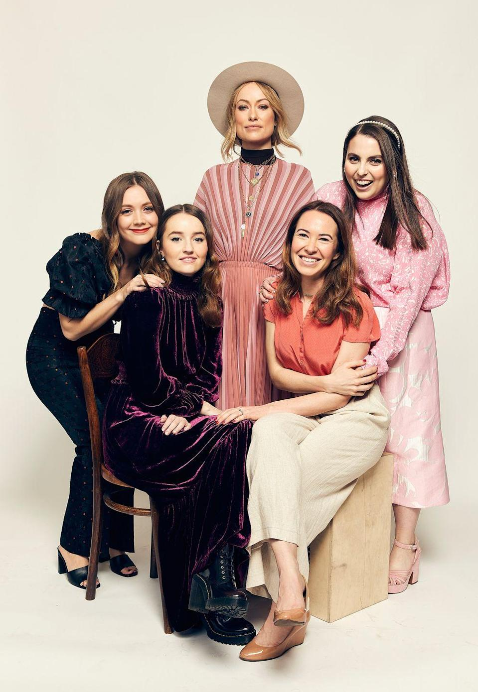 <p>Posing alongside the stars of her directorial-debut film Booksmart (Billie Lourd, Beanie Feldstein and Kaitlyn Dever), Wilde rocks a 1970s-inspired look consisting of a striped salmon-coloured dress with a thick black high-neck and a wide-rimmed hat. </p>