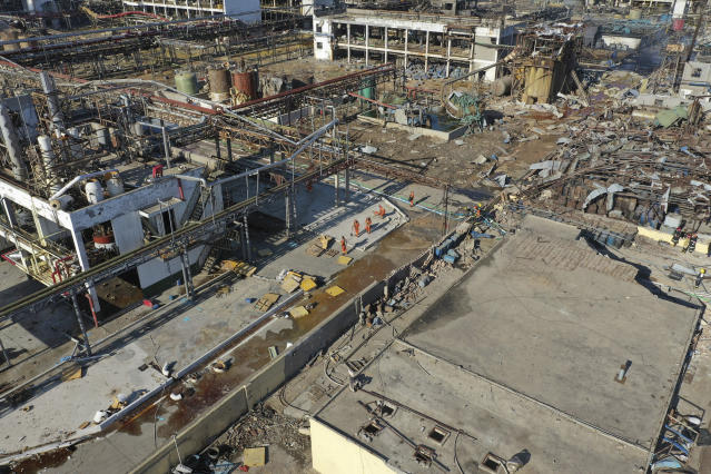 In this aerial photo released by China's Xinhua News Agency, rescuers work at the site of a factory explosion in a chemical industrial park in Xiangshui County of Yancheng in eastern China's Jiangsu province, Friday, March 22, 2019. The local government reports the death toll in an explosion at a chemical plant in eastern China has risen with dozens killed and more seriously injured. (Ji Chunpeng/Xinhua via AP)