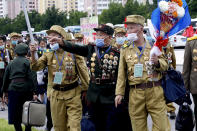 """War veterans head to a hotel to attend a national conference of war veterans on the occasion of the 67th anniversary of the end of the Korean War, which the country celebrates as the day of """"victory in the fatherland liberation war"""" in Pyongyang, North Korea, Saturday, July 25, 2020. (AP Photo/Jon Chol Jin)"""