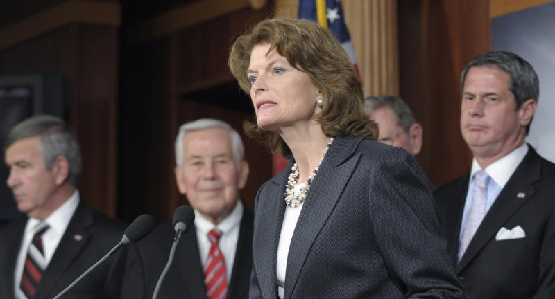 FILE - In this Nov. 30, 2011, file photo, Sen. Lisa Murkowski, R-Alaska, center, joins other Republican senators during a news conference on Capitol Hill in Washington. Murkowski says she saw it coming, even before the public scolding last weekend, March 2012, at Alaska's Iditarod dog sled race. Siding with Republican leaders on a contentious contraceptives vote was a mistake. A moderate in an era of paralyzing partisanship, Murkowski, 54, may be a natural heir to the centrist role played by retiring Maine Sen. Olympia Snowe. From left, Republican senators Mike Johanns, R-Neb., Richard Lugar, R-Ind., and Sen. David Vitter, R-La. (AP Photo/Susan Walsh, File)