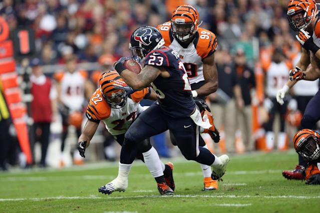 HOUSTON, TX - JANUARY 05: Arian Foster #23 of the Houston Texans runs the ball against Nate Clements #22 of the Cincinnati Bengals during the AFC Wild Card Playoff Game at Reliant Stadium on January 5, 2013 in Houston, Texas. (Photo by Ronald Martinez/Getty Images)