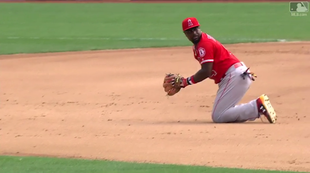 Brandon Phillips prepares to flip the ball behind his back to start a double play. (MLB.com)