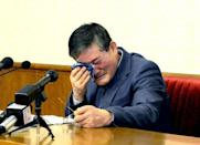 A man who identified himself as Kim Dong Chul, who previously said he was a naturalised American citizen and was arrested in North Korea in October, attends a news conference in Pyongyang, North Korea, in this undated photo released by North Korea's Korean Central News Agency (KCNA) in Pyongyang March 25, 2016. KCNA/via Reuters/File Photo