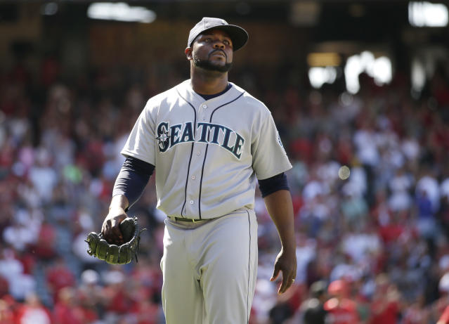 Seattle Mariners relief pitcher Fernando Rodney walks off the field after the team's 6-5 loss to the Los Angeles Angels in a baseball game on Sunday, July 20, 2014, in Anaheim, Calif. (AP Photo/Jae C. Hong)