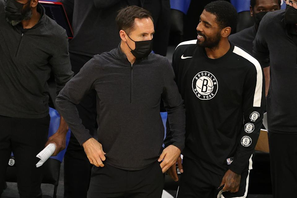 Brooklyn Nets head coach Steve Nash looks on with Kyrie Irving #11 of the Brooklyn Nets during the preseason game against the Boston Celtics at TD Garden on December 18, 2020 in Boston, Massachusetts. NOTE TO USER: User expressly acknowledges and agrees that, by downloading and or using this photograph, User is consenting to the terms and conditions of the Getty Images License Agreement.  (Photo by Maddie Meyer/Getty Images)