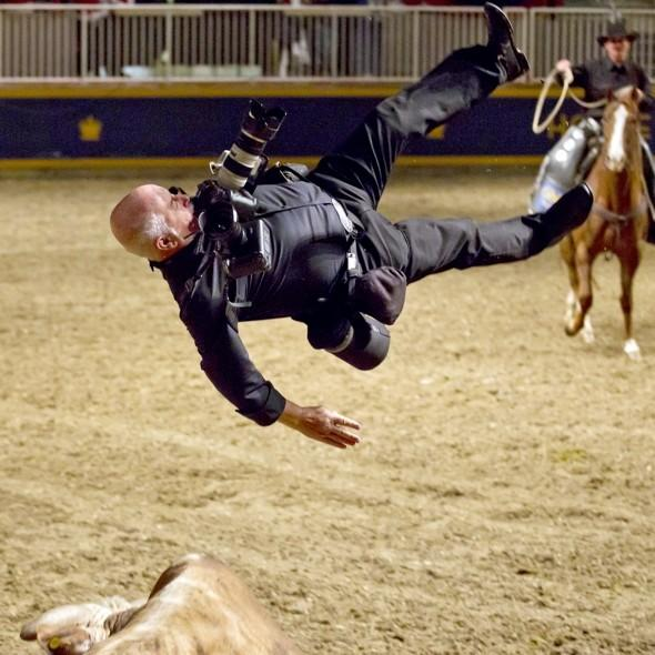 Photographer sent flying by charging bull at 2013 Royal Horse Show in Toronto