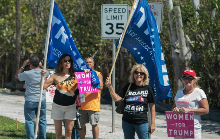 Supporters of US President Donald Trump are seen near his Mar-a-Lago estate in Palm Beach, Florida on March 18, 2017