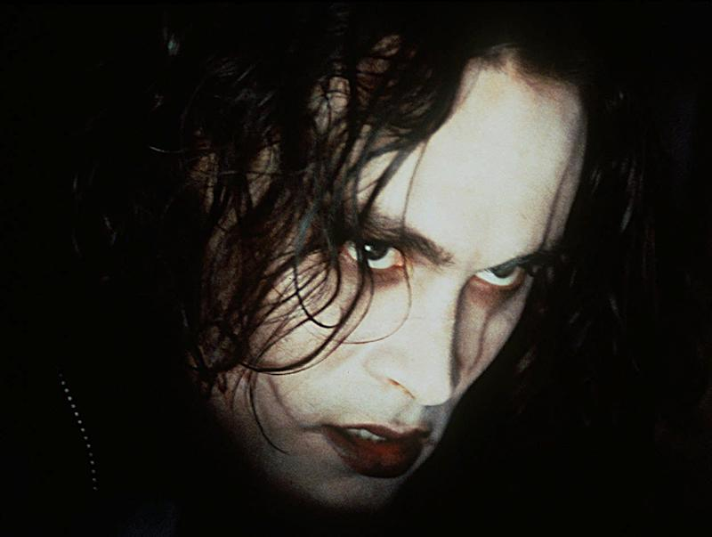 "The late Brandon Lee starred as a rock star resurrected to avenge his beloved's murder in ""The Crow."""