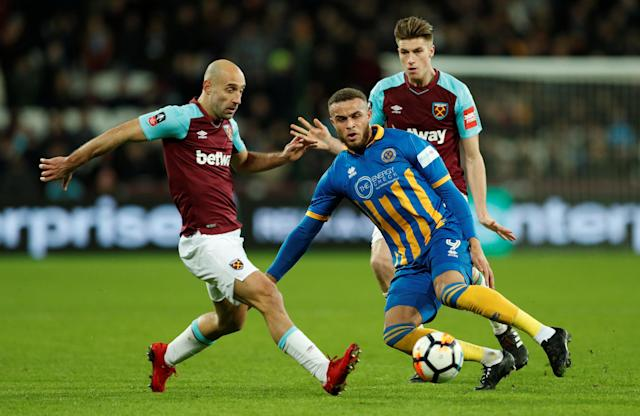 Soccer Football - FA Cup Third Round Replay - West Ham United vs Shrewsbury Town - London Stadium, London, Britain - January 16, 2018 Shrewsbury Town's Carlton Morris in action with West Ham United's Pablo Zabaleta and Reece Burke Action Images via Reuters/John Sibley