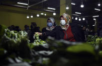 """People shop in a market in Istanbul, Saturday, May 8, 2021, after they were allowed to open during the strict lockdown. The markets, or """"bazaars,"""" integral to Turkish food culture with producers bringing their fruits and vegetables to nearly every neighborhood on set days of the week, were allowed to open Saturday across Turkey as the country's strictest lockdown to fight COVID-19 continues amid an economic downturn with double digit inflation. (AP Photo/Emrah Gurel)"""