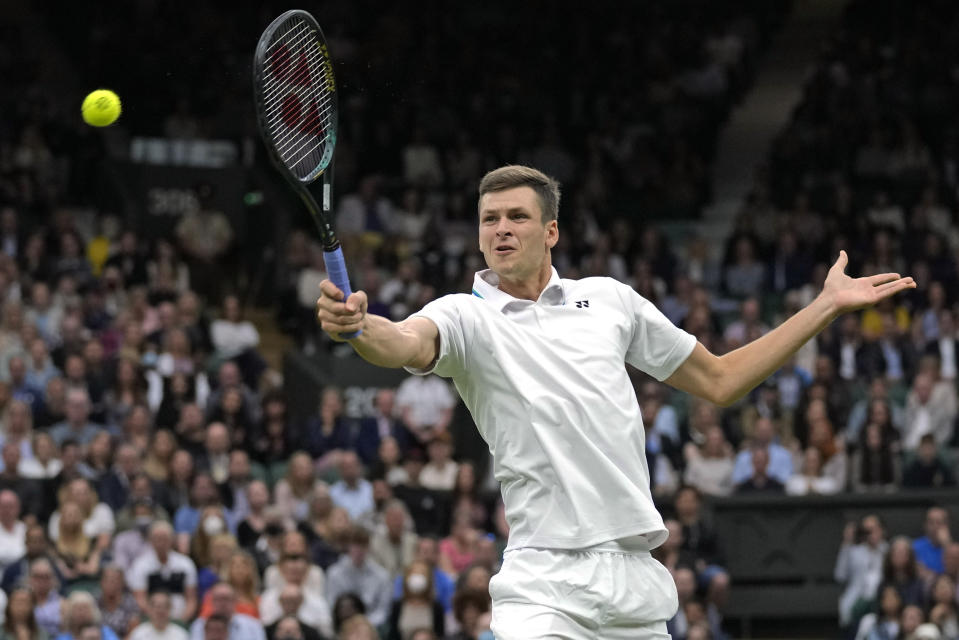 Poland's Hubert Huekacz plays a return during the men's singles fourth round match against Russia's Daniil Medvedev on day eight of the Wimbledon Tennis Championships in London, Tuesday, July 6, 2021. (AP Photo/Kirsty Wigglesworth)