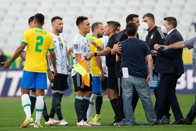Brazil and Argentina players talk after their World Cup qualifying match in Sao Paulo is suspended due to alleged coronavirus breaches