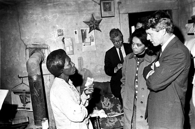 <p>Sen. Robert F. Kennedy in the Mississippi Delta near Greenville, April 11, 1967, with Marian Wright, second from right. (Photo: Jack Thornell/AP) </p>