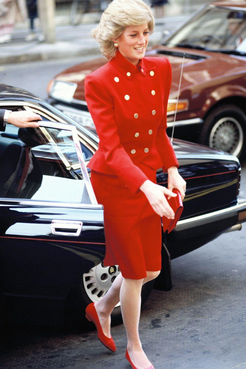 <p>In a red jacket, skirt and ballet while visiting St. Mary's Hospital in London. </p>