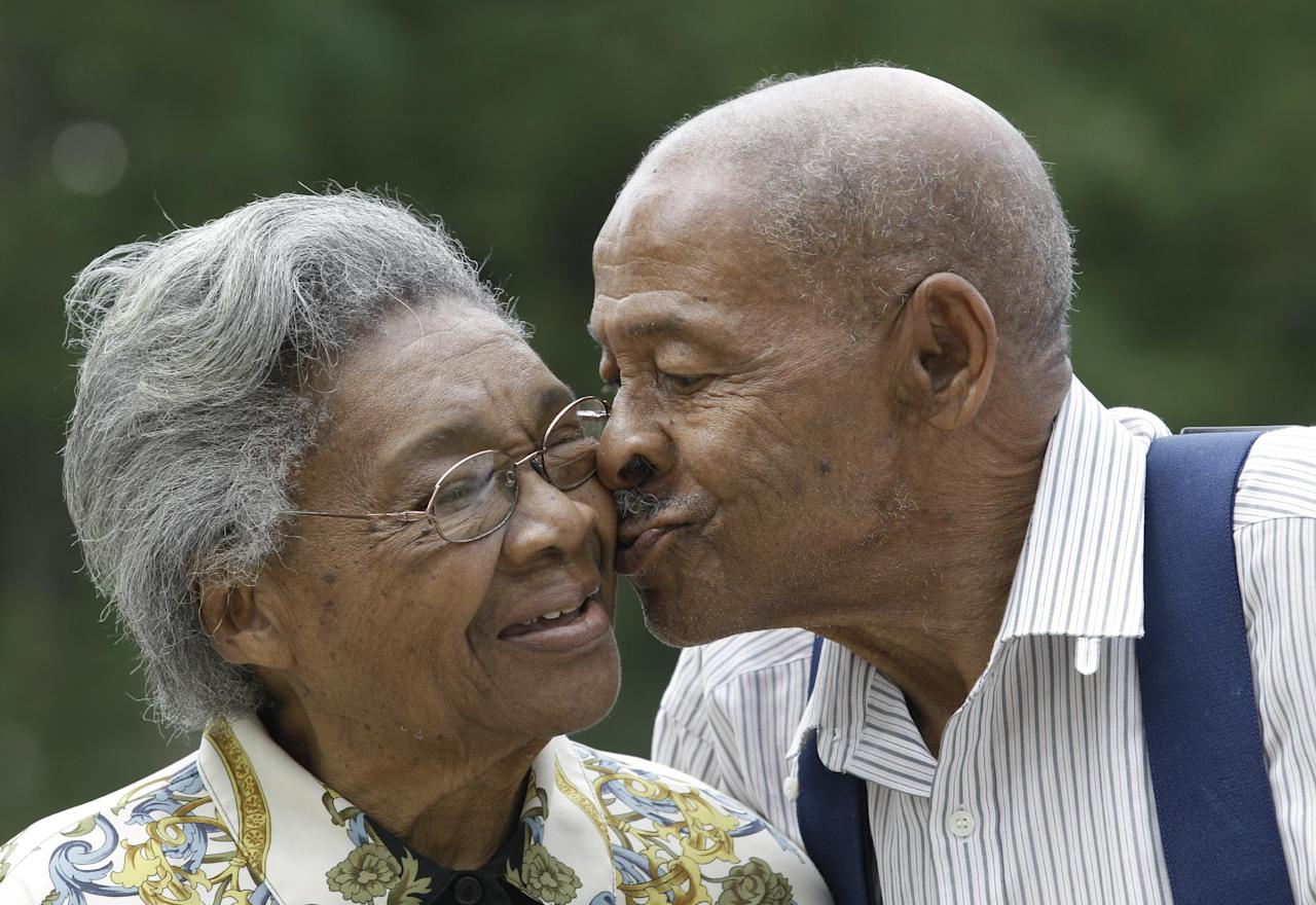 Roland Davis and Lena Henderson, both 85, kiss as they pose for a photo in West Seneca, N.Y., Tuesday, July 31, 2012. They got married while still in their teens, divorced 20 years later and are getting remarried on Saturday, August 4, after nearly a half-century apart. (AP Photo/David Duprey)