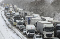 <p>Stationary traffic stands on the M20 near Ashford, Kent, southeast England following overnight snowfall which has caused disruption across Britain. Roads across Britain have already seen a good covering snow, with police forces reporting treacherous driving conditions and blocked routes. (Gareth Fuller/PA via AP) </p>