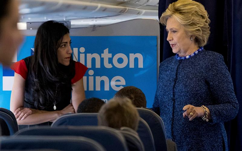 Democratic presidential candidate Hillary Clinton speaks with senior aide Huma Abedin - Credit: Andrew Harnik/AP