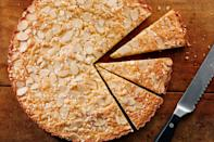 "Baking it in a tart pan gilds this simple Easter dessert with a pretty, fluted edge. A scattering of flaked almonds and pearl sugar adds a fun crunch. <a href=""https://www.epicurious.com/recipes/food/views/sunshine-cake?mbid=synd_yahoo_rss"" rel=""nofollow noopener"" target=""_blank"" data-ylk=""slk:See recipe."" class=""link rapid-noclick-resp"">See recipe.</a>"