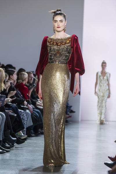 The Badgley Mischka collection is modeled at Spring Studios during NYFW Fall/Winter 2020 on Saturday, Feb. 8, 2020, in New York. (Photo by Charles Sykes/Invision/AP)