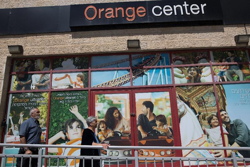 Orange will pay up to 90 million euros ($100 million) to regain direct control of the brand, which had been licenced to Partner to use in Israel until 2025 (AFP Photo/Menahem Kahana)