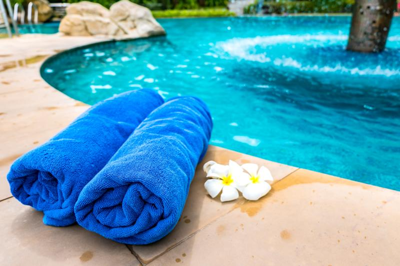 The towel is placed by the Swimming Pool