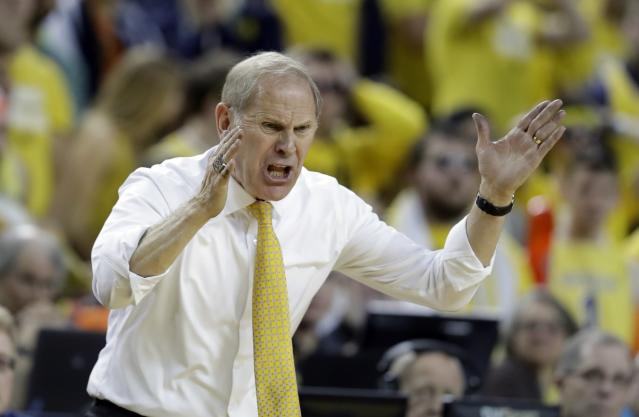 Michigan head coach John Beilein yells from the sidelines during the second half of an NCAA college basketball game against Minnesota, Saturday, Feb. 3, 2018, in Ann Arbor, Mich. (AP Photo/Carlos Osorio)