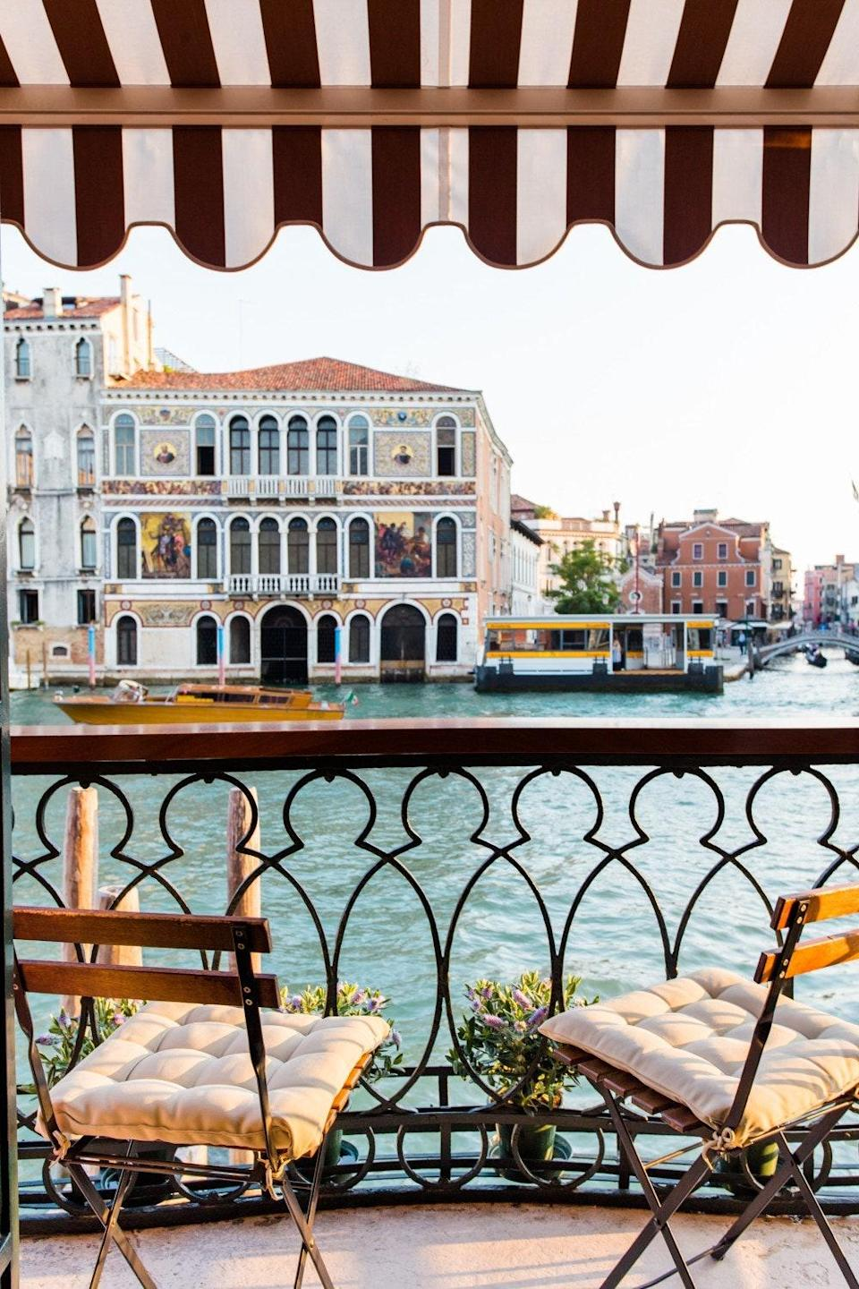 """If you want to get up close and personal with Venice's hustle and bustle, pony up for this apartment directly on the Grand Canal. You'll want to schedule some time to sit out on the patio and watch boats fly by. The inside lives up to the outside's standards too, with a leafy green Venetian-plastered living room, two bedrooms, and a fully stocked kitchen. This is an <a href=""""https://www.cntraveler.com/story/airbnb-plus-is-for-people-who-hate-airbnb?mbid=synd_yahoo_rss"""" rel=""""nofollow noopener"""" target=""""_blank"""" data-ylk=""""slk:Airbnb Plus"""" class=""""link rapid-noclick-resp"""">Airbnb Plus</a> after all, meaning it's passed a 100-point inspection including having closet and drawer space for guests, a well-lit entry, easy check-in, comfortable mattresses, a coffee maker, and toiletries like shampoo. Bonus: You won't have to worry about finding your way to the apartment on Venice's busy streets with your luggage, as the host Mariacaterina will organize a private water taxi to take you directly from the airport to your Airbnb's front door. $471, Airbnb (Starting Price). <a href=""""https://www.airbnb.com/rooms/plus/7314165"""" rel=""""nofollow noopener"""" target=""""_blank"""" data-ylk=""""slk:Get it now!"""" class=""""link rapid-noclick-resp"""">Get it now!</a>"""