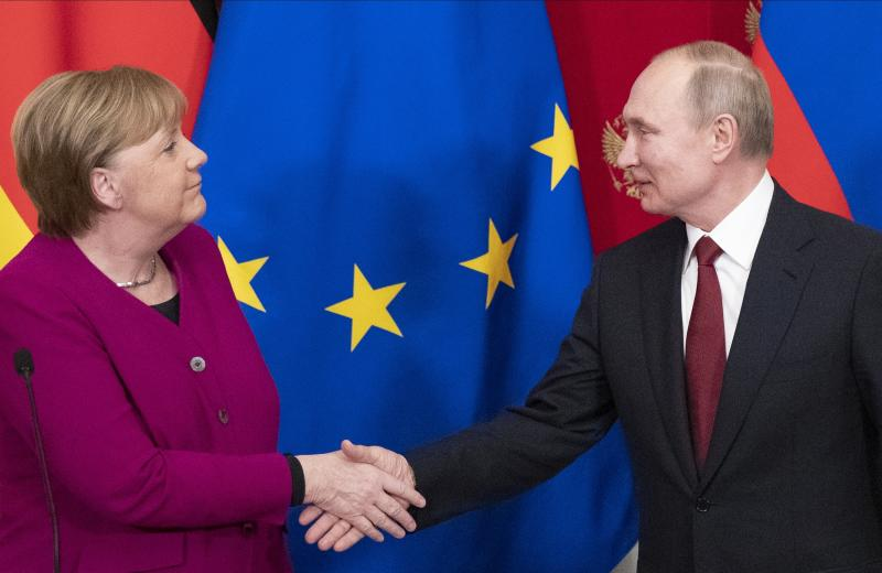 German Chancellor Angela Merkel and Russian President Vladimir Putin shake hands after their joint news conference following their talks in the Kremlin in Moscow, Russia, Saturday, Jan. 11, 2020. Merkel visits Moscow to discuss current international issues such as the situation in Syria, Libya, Ukraine, US-Iran tensions, as well as bilateral relations. (AP Photo/Pavel Golovkin, Pool)