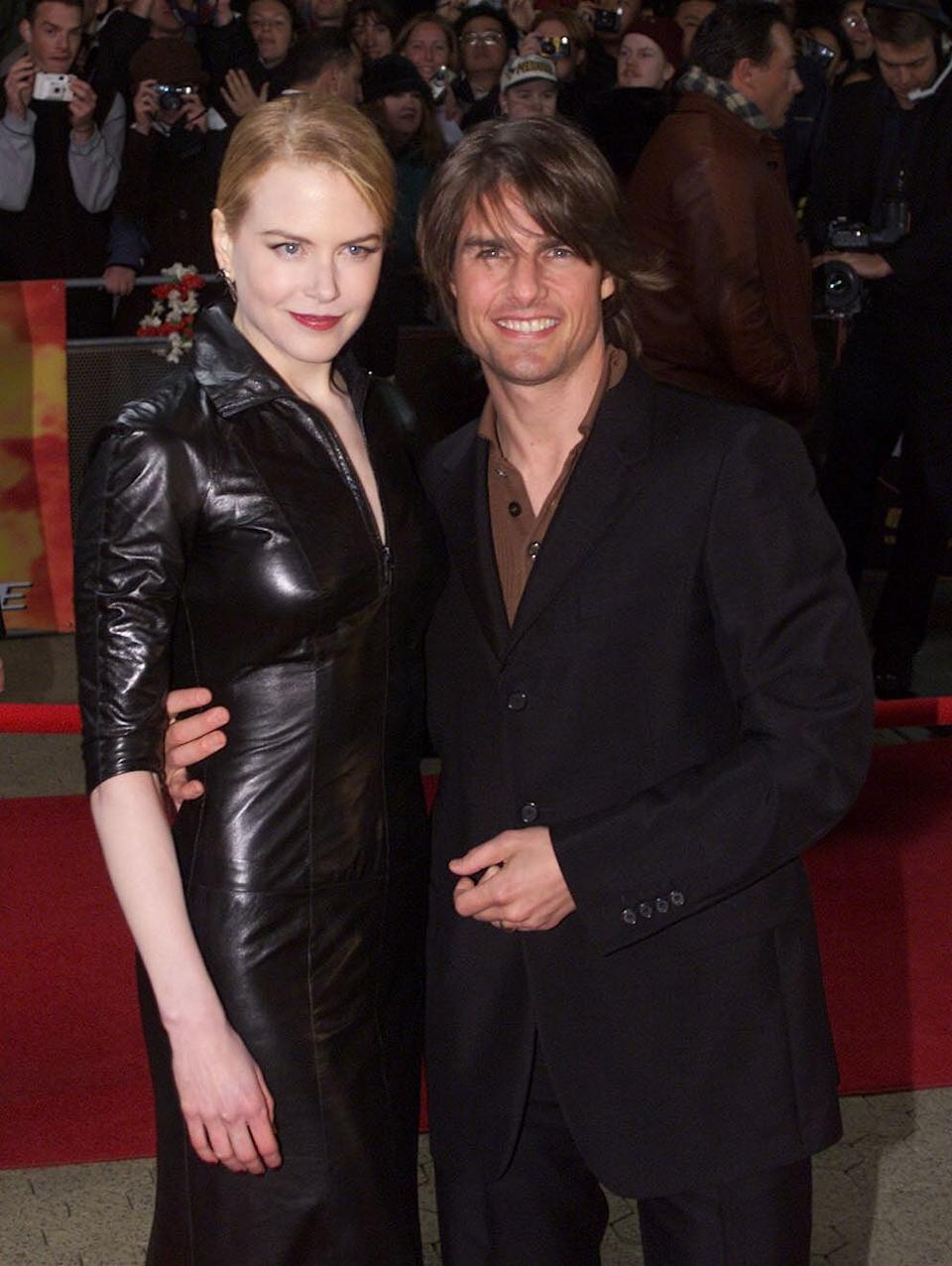 """370226 12: FILE PHOTO: Actor Tom Cruise and his wife Nicole Kidman pose for photographers at the Sydney premiere of """"Mission Impossible 2"""" May 30, 2000 at Fox Studios in Australia. Cruise and Kidman, one of the Hollywood's best-known couples, announced February 5, 2001 that they are separating after more than a decade of marriage. (Photo by Matt Turner/Liaison)"""