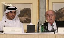 Chairman of the Qatar 2022 bid committee Sheikh Mohammed bin Hamad al-Thani (left) and FIFA president Sepp Blatter attend a press conference in the Qatari capital Doha on November 9, 2013