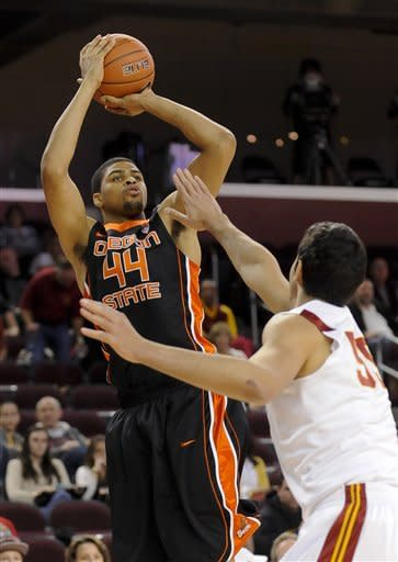 Oregon State forward Devon Collier (44) shoots over Southern Cal center Omar Oraby (55) for a basket during the first half of an NCAA college basketball game, Saturday, Jan. 19, 2013, in Los Angeles. (AP Photo/Gus Ruelas)