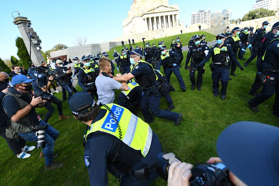 A Protester scuffles with with Police outside of the Shrine of Remembrance in Melbourne. Source: AAP