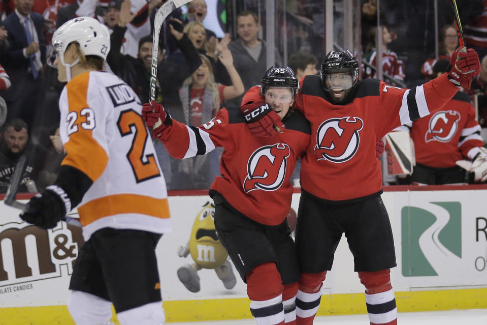 New Jersey Devils' Sami Vatanen, back left, celebrates his goal with P.K. Subban during the second period of the team's NHL hockey game against the Philadelphia Flyers in Newark, N.J., Friday, Nov. 1, 2019. (AP Photo/Seth Wenig)