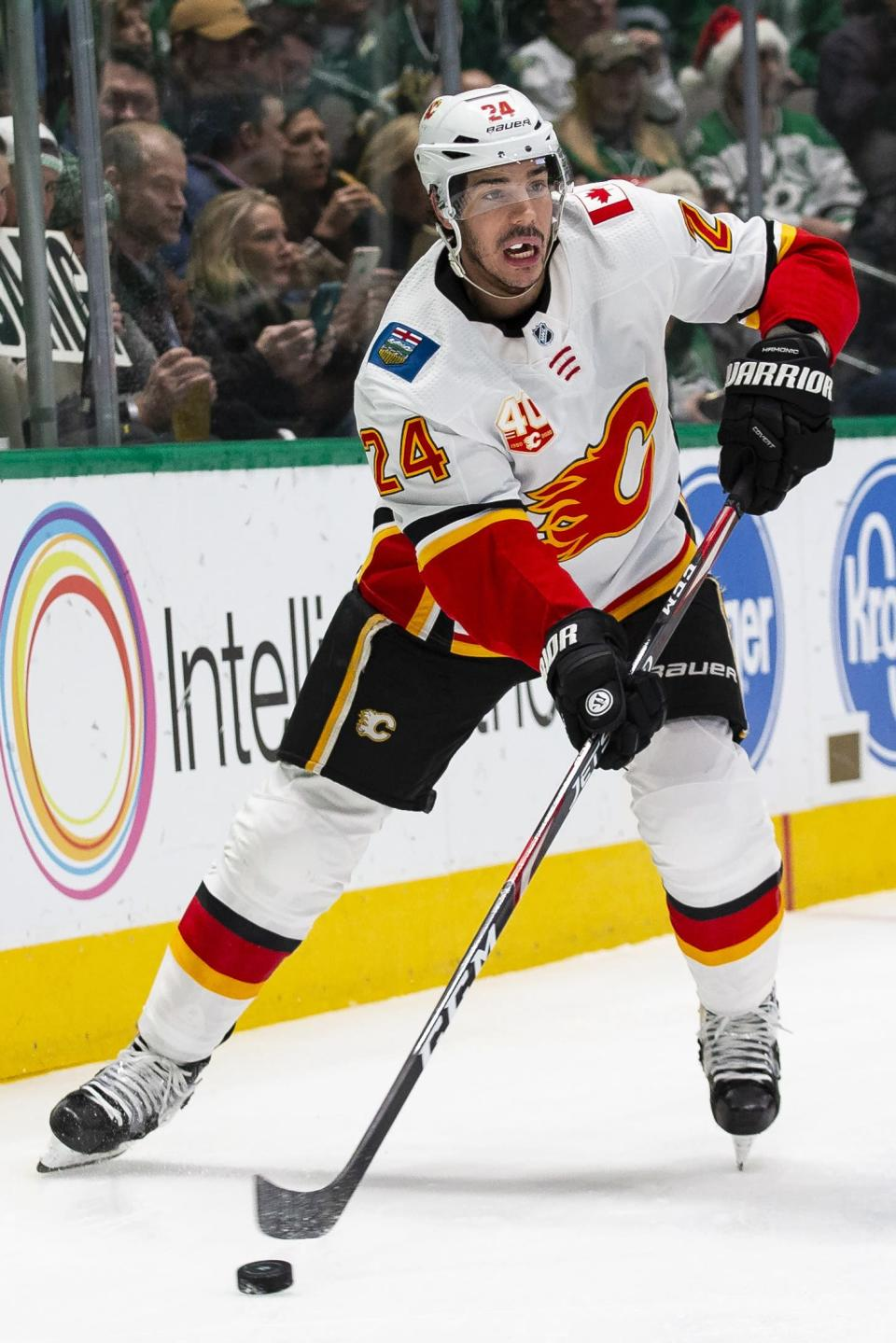 Calgary Flames defenseman Travis Hamonic (24) looks to pass the puck during the first period of an NHL hockey game against the Dallas Stars, Sunday, Dec. 22, 2019, in Dallas. (AP Photo/Sam Hodde)