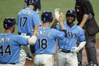 Tampa Bay Rays' Randy Arozarena, right, celebrates with teammates, including Austin Meadows, Joey Wendle and Kevan Smith after his three-run home run off New York Yankees starting pitcher Michael King during the sixth inning of a baseball game Thursday, May 13, 2021, in St. Petersburg, Fla. (AP Photo/Chris O'Meara)