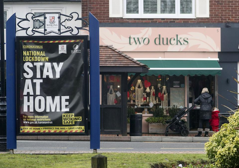 General view of signage at St John's near Woking, Surrey. Residents in a part of Surrey are to be urgently tested for Covid-19 after it emerged the South African strain of the virus may have started spreading in the community. Two positive cases of the strain - which has been worrying scientists - have been identified in people with no links to travel or previous contact with those affected. Picture date: Monday February 1, 2021.
