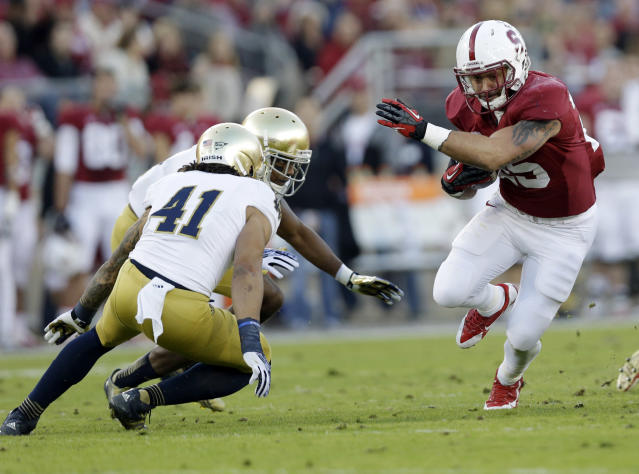 Stanford running back Tyler Gaffney, right, runs against Notre Dame during the first half of an NCAA college football game on Saturday, Nov. 30, 2013, in Stanford, Calif. Stanford won 27-20. (AP Photo/Marcio Jose Sanchez)