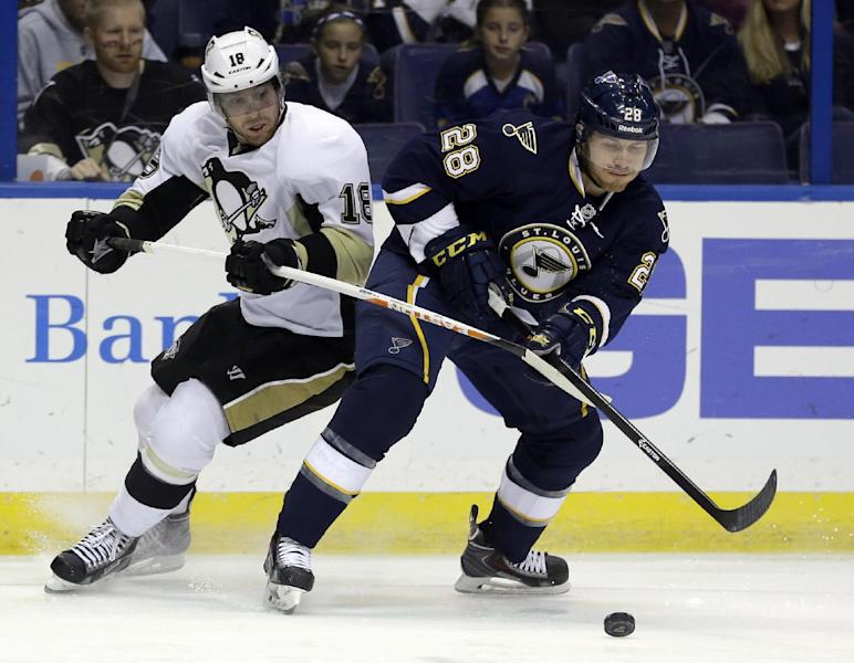 Pittsburgh Penguins' James Neal, left, and St. Louis Blues' Ian Cole chase after a loose puck during the first period of an NHL hockey game on Saturday, Nov. 9, 2013, in St. Louis. (AP Photo/Jeff Roberson)