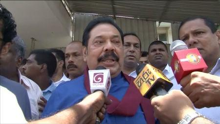 Former president and current leader of opposition party, Mahinda Rajapaksa, speaks to media in Negombo, Sri Lanka, April 21, 2019 in this still image obtained from video.  Derana TV/via Reuters TV
