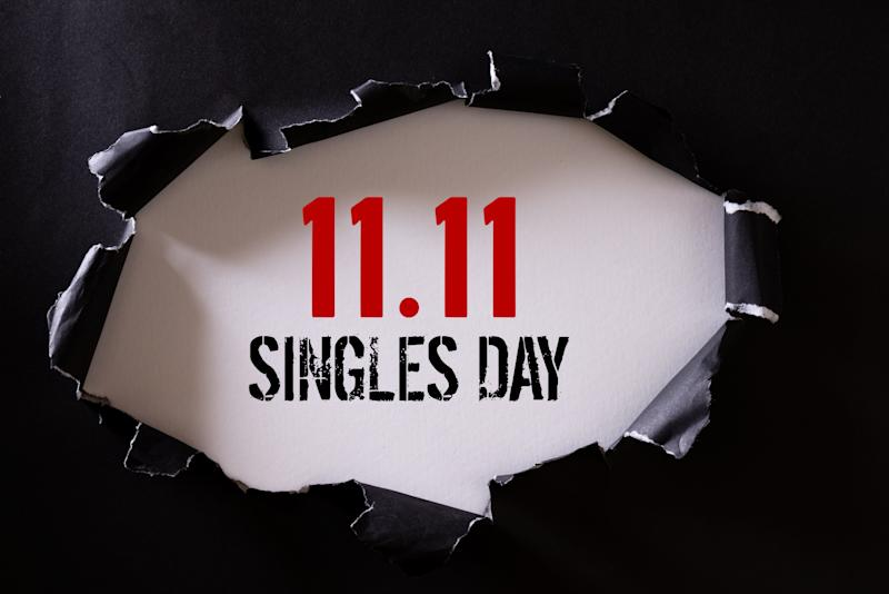 Online shopping of China, 11.11 singles day sale concept. Top view of Black torn paper and the text 11.11 singles day sale on a white background.
