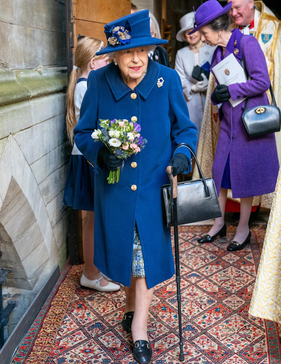 The Queen using walking stick