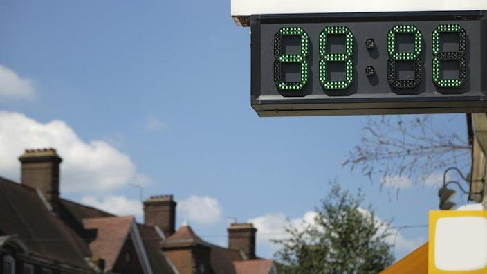 A digital thermometer in London showing the temperature during the UK heat wave. It reads 38 °C
