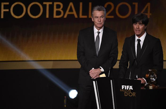 Germany's coach Joachim Loew (R) speaks next to Switzerland's German coach Ottmar Hitzfeld (L) after receiving the 2014 FIFA World Coach of the Year at the Ballon d'Or award ceremony at the Kongresshaus in Zurich on January 12, 2015 (AFP Photo/Olivier Morin)